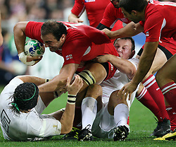 Georgia's Mamuka Gorgodze in the tackle of England's Tom Palmer in the Rugby World Cup pool match at Otago Stadium, Dunedin, New Zealand, Sunday, September 18, 2011. Credit:SNPA / Dianne Manson.