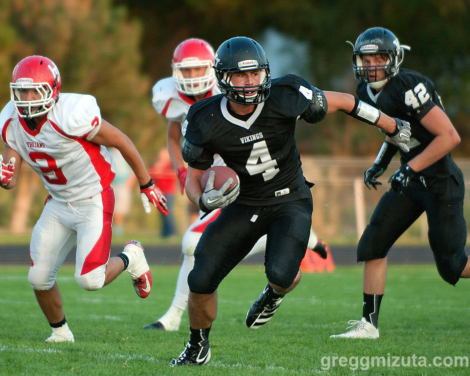 Andrew Weber breaks loose for a long run during the Vale - Homedale football game, September 12, 2014 at Frank Hawley Stadium in Vale, Oregon. Weber finished with 98 rushing yards, two touchdowns and 3 PAT. Vale won 33-20 to improve their record to 2-0.
