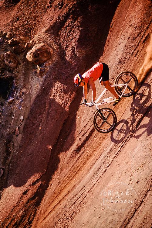 Mountain biking down a very steep dirt hill