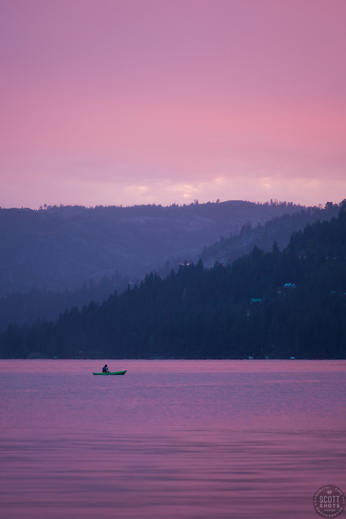 """""""Kayak on Donner Lake Sunset"""" - Photograph of a kayaker fishing on Donner Lake at sunset, shot from the East end of Donner."""