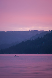 """Kayak on Donner Lake Sunset"" - Photograph of a kayaker fishing on Donner Lake at sunset, shot from the East end of Donner."
