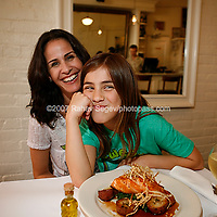 Owner Stacey Sosa  with her daughter Anabel Sosa and one of Estancia 460's dishes, a plate of Salmon with Pomegranate Orange Glaze and Frizzled Leeks. Shot at the restaurant on May 25th, 2007..Photo Credit; Rahav Segev/Photopass