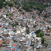 Rocinha, the largest favela in Rio de Janeiro, Brazil as seen from Estrada da Gávea. Busy area on a very steep hill surrounded by trees!