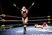 Lucha Libre AAA wrestler Pimpenela exults over a defeated Deccnis at a match in Sacramento, CA March 28, 2009.