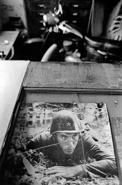 ALBANIA - Albanien - 1991 - Transition from communism to democracy; Military memories & Propaganda seen in a shop with an old motorcycle...;  10/1991; © Christian Jungeblodt