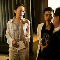 BEIJING, MAY-22 :   guests  talk during the cocktail invitation before the Balmain spring/summer 2012 show.