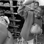 Some 60 other girls are to be examined for virginity by a group of mothers in Magqabasini village, near Flagstaff in the former Transkei July 20, 1999.  This tradition has been revived to combat child abuse and high rates of teenage pregnancies and the spread of HIV. (Greg Marinovich)