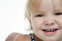 21 July 2008: Closeup of face of girl two year old toddler Lucy Berg on a white background in studio.