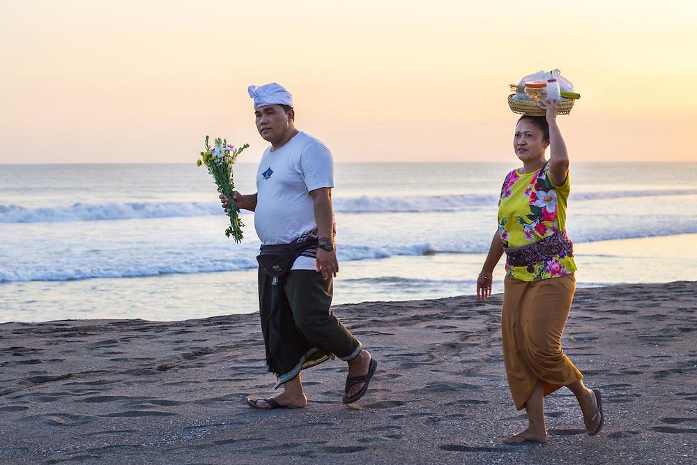 Bringing offerings to a temple at Kayu Putih beach in Canggu.