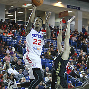Delaware 87ers Guard Jamal Jones (22) drives towards the basket as Erie BayHawks Guard Seth Curry (12) defends in the first half of a NBA D-league regular season basketball game between the Delaware 87ers and the Erie BayHawk (Orlando magic) Friday, Jan. 02, 2015 at The Bob Carpenter Sports Convocation Center in Newark, DEL