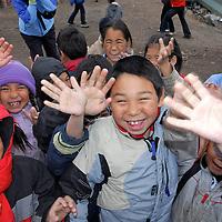 Children playing on a school break. School. Coastal Inuit community of Arctic Bay. Lancaster Sound. HIgh Arctic. Baffin Island. .(people, kid,