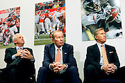 SHOT 3/20/12 1:34:08 PM - The Denver Broncos' (left to right) head coach John Fox; owner Pat Bowlen and executive vice president of football operations John Elway listen on as free agent quarterback Peyton Manning speaks at team headquarters in Englewood, Co. at a press conference on Tuesday Marc 20, 2012. Manning is coming off neck surgery and was released by the Indianapolis Colts. He signed a five year, $96 million contract with the Broncos..(Photo by Marc Piscotty / © 2012)