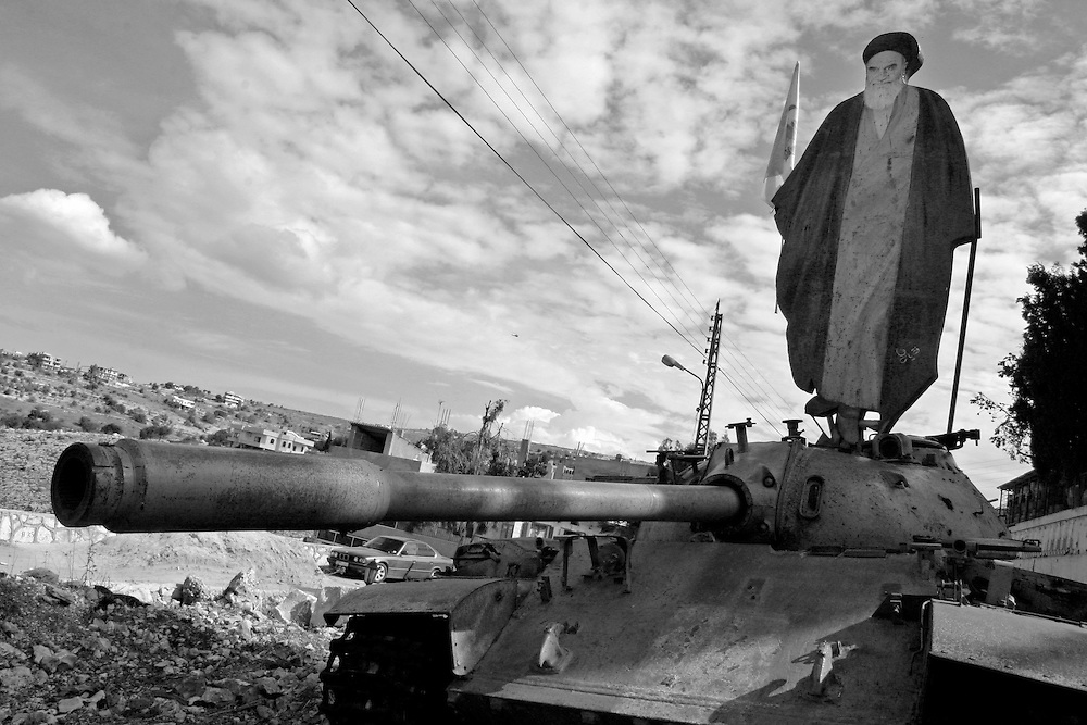 SOUTH LEBANON: A cut-out billboard depicting the Ayatollah Khomeini stands on an abandoned T-55 tank that was supplied by the Israelis to the South Lebanese Army during the civil war.
