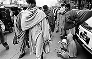 An Afghan woman begs for small change on Khyber Road Old City Peshawar Pakistan Jan 2002..