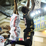 Erie BayHawks Forward CJ Leslie (11) dunks as Delaware 87ers defender Forward Damian Saunders (18) defends in the second half of a NBA D-league regular season basketball game between the Delaware 87ers (76ers) and the Erie BayHawks (Knicks) Tuesday, Feb. 11, 2014 at The Bob Carpenter Sports Convocation Center, Newark, DE