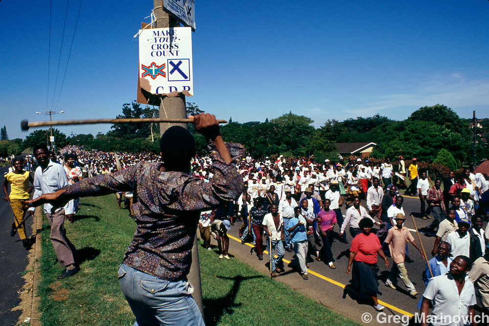 Empangeni, KwaZulu Natal, 1994, South Africa: Inkatha  supporters vanadlize opposition posters in  Empangeni, Zululand South Africa, 1994