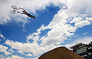 Cam Pianta (cq), 19, of Benalla, Australia flies off the first hit in the BMX Dirt Open Qualifier at the Dew Action Sports Tour, the only season-long professional action sports tour, which is making its second stop of the season in Denver with the Right Guard Open. The event takes place Thursday July 13 through Sunday July 16, 2006 in and around the Pepsi Center. Athletes were already in town for practice sessions and qualifying rounds on Wednesday July 12, 2006..(MARC PISCOTTY/ © 2006)