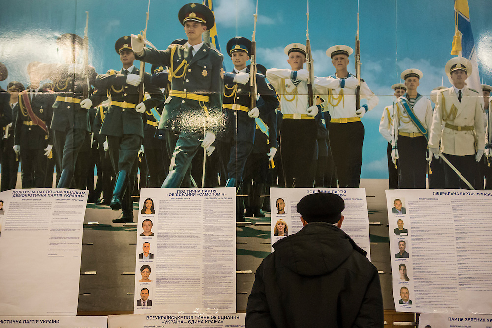 KIEV, UKRAINE - OCTOBER 26: A man reviews informational posters about parliamentary candidates at a polling station on October 26, 2014 in Kiev, Ukraine. The country's parliamentary elections are seen as key to President Petro Poroshenko's ability to advance his agenda. (Photo by Brendan Hoffman/Getty Images) *** Local Caption ***