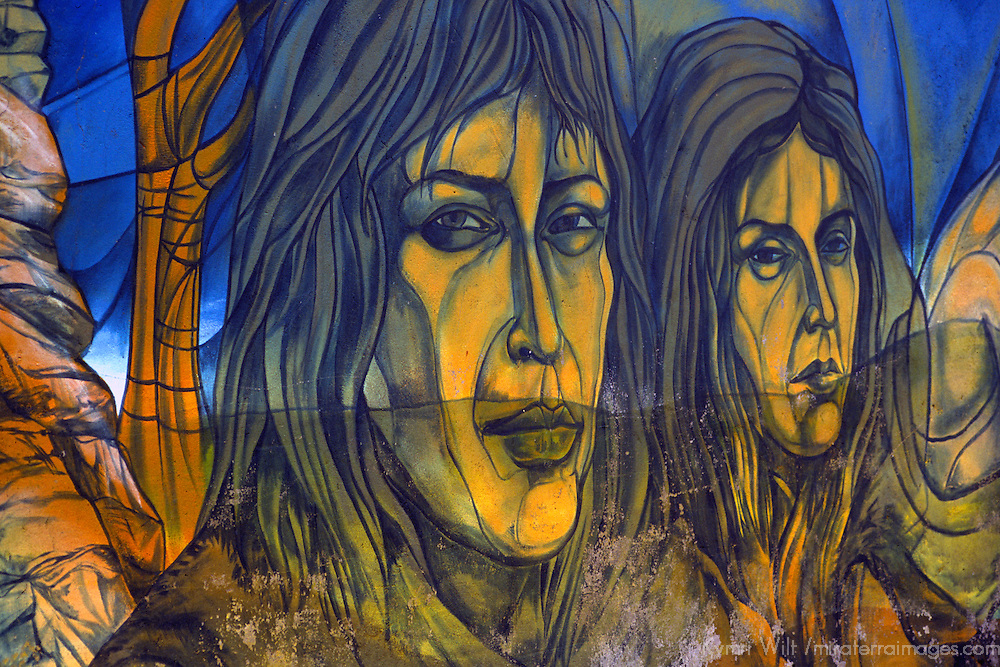 Americas, South America, Chile, Puerto Natales. Part of the mural painted along the wall of the local futbol stadium in Puerto Natales.