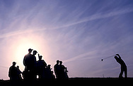 The sun rises behind the 11th tee at TPC Scottsdale, February 2006. Photograph by Darren Carroll.