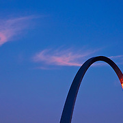 St. Louis arch with sunset reflection.