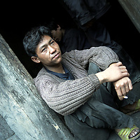 Wu Ci Re, coal miner. Outside the home he shares with a group of co-workers.  Yushe Coal Mine, illegal coal mine on the Laoying Mountain.