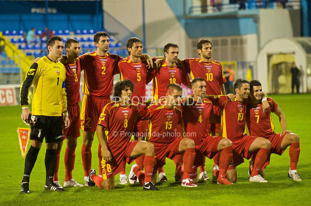 PODGORICA, MONTENEGRO - Wednesday, August 12, 2009: Montenegro's players line-up for a team group photograph before an international friendly match against Wales at the Gradski Stadion. Back row L-R: captain goalkeeper Vukasin Poleksic, Milan Jovanovic, Miodrag Dzudovic, Radoslav Batak, Nikola Drincic, Radomir Dalovic. Front row L-R: Stevan Jovetic, Milorad Pekovic, Savo Pavicevic, Vladimir Bozovic, Simon Vukcevic. (Photo by David Rawcliffe/Propaganda)