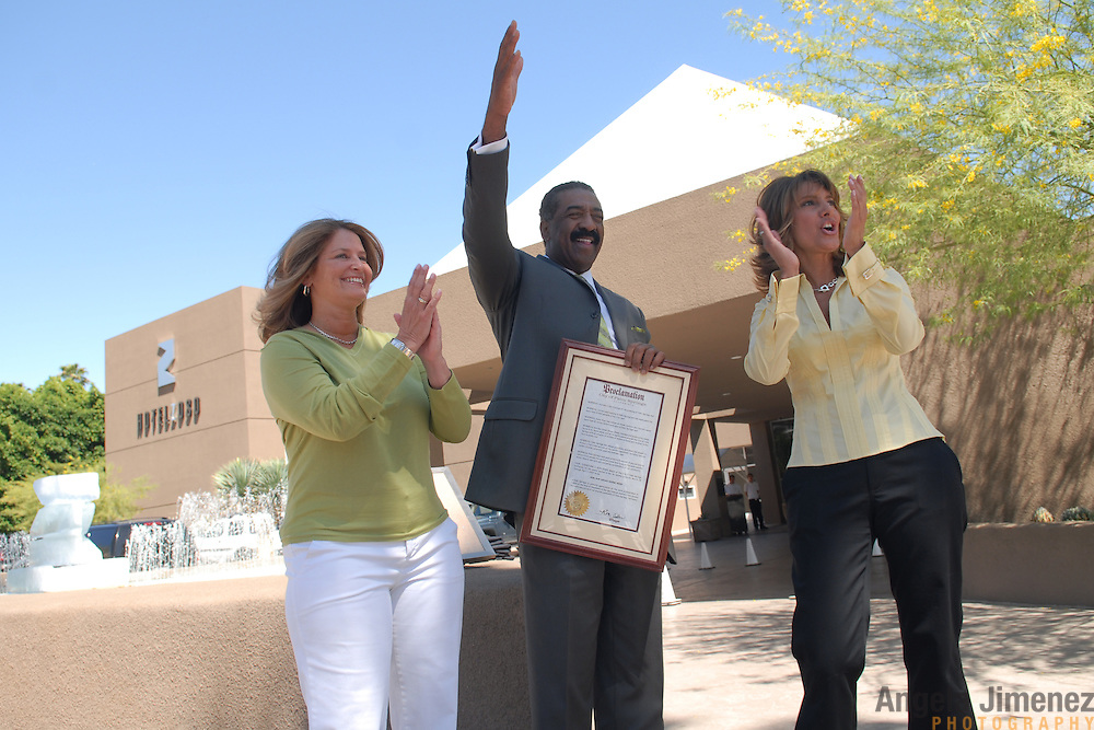 """Lesbian party promoters Robin Gans, left, and Sandy Sachs, right, receive a proclamation from Ron Oden, center, the mayor of Palm Springs, California, declaring March 28 through April 1, 2007 """"Girl Bar Dinah Shore Week"""" during a press conference in front of Hotel Zoso in Palm Springs on March 29, 2007. ..The women's company, Girlbar, runs five days of parties during the Dinah Shore weekend, an annual lesbian gathering run simultaneously with the Kraft Nabisco Championship LPGA golf tournament. Hotel Zoso is Girlbar's """"VIP"""" headquarters during the events. ..The mayor issues a similar proclamation each year to Club Skirts, the rival lesbian circuit party which is held at the same time. """"The split has been good for the city,"""" the Mayor said of the division of one lesbian party circuit into two. """"It's doubled the event."""".."""