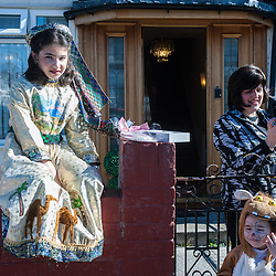 London, UK - 16 March 2014: Dassy, 10 (Left) dressed in fancy clothes celebrates with her family the festivity of Purim, dancing and singing in the streets at the sound of Yiddish music and visiting wealthy businessmen collecting for their charity
