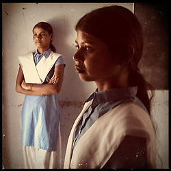 iPhone portrait of (L-R) Choti Bairwa, 15, and Jyoti Bairwa, 12, in a village of Rajasthan, India, April 3, 2013. &quot;To other girls like me, I would like to say that don&rsquo;t get married at a young age. Because it is harmful. It is harmful,&quot; said one girl.<br />  <br /> Under Indian law, children younger than 18 cannot marry. Yet in a number of India&rsquo;s states, at least half of all girls are married before they turn 18, according to statistics gathered in 2012 by the United Nations Population Fund (UNFPA). However, young girls in the Indian state of Rajasthan&mdash;and even a few boys&mdash;are getting some help in combatting child marriage. In villages throughout Tonk, Jaipur and Banswara districts, the Center for Unfolding Learning Potential, or CULP, uses its Pehchan Project to reach out to girls, generally between the ages of 9 and 14, who either left school early or never went at all. The education and confidence-building CULP offers have empowered young people to refuse forced marriages in favor of continuing their studies, and the nongovernmental organization has provided them with resources and advocates in their fight.