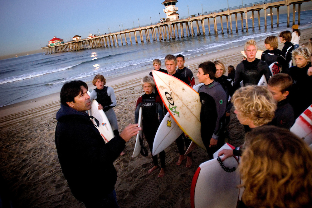 Huntington Beach, California, Surf City, USA..Huntington Beach is a legendary surf beach in California. The surf shop Rockin' Fig Headquarters, run by legendary surfer Rockin Fig, attracts local characters and young surfing talents... ..Huntington Beach High School Surf Team - morning practice....Photographer: Chris Maluszynski /MOMENT