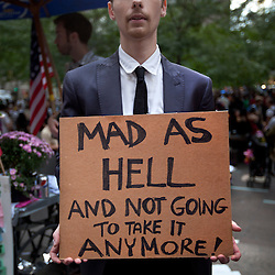 Protesters march during the Occupy Wall Street demonstrations in New York, N.Y., Oct. 1, 2011.
