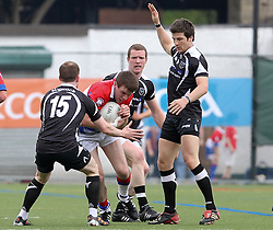 May 6, 2012; Bronx, NY; USA; New York's Mike Jim Fitzgerald (8) runs with the ball while being defended by Sligo's Mark Breheny (15) and Brendan Egan (10) during their game at Gaelic Park.