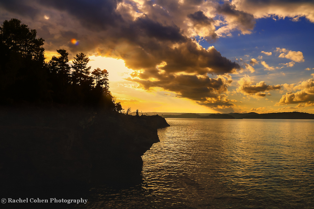 &quot;The Day After&quot; <br /> <br /> Rock cliffs and trees in silhouette above Lake Superior at sunset!