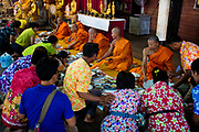 Devotees serve monks breakfast at the local temple on the first day of Songkran in Nakhon Nayok, Thailand. PHOTO BY LEE CRAKER