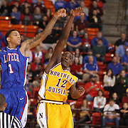 ULM's Tylor Ongwae (12) and  Louisiana Tech's Michale Kyser (1) fight for the ball during the first half of an NCAA men's basketball at Fant-Ewing Coliseum, Sunday, Dec. 22, 2013.