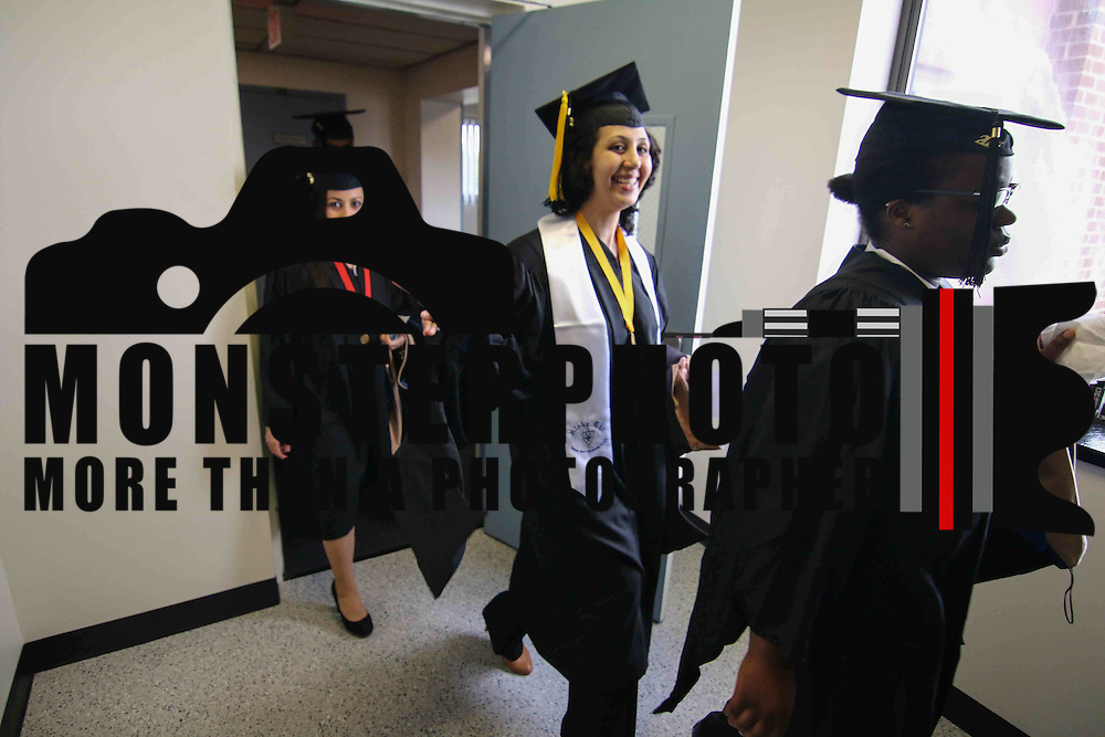 Goldey-Beacom College candidates for graduation seen walking to the venue prior Goldey-Beacom commencement exercise Friday, May 1, 2015, at Joseph West Jones College Center on the campus of Goldey-Beacom College in Wilmington Delaware.