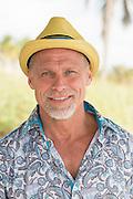 portrait of a handsome mature man in a fun hat