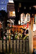 Throwing water on Buddha image at Hozenji Temple, Dotonburi/Minami area.