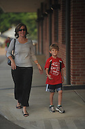 Kristin Newman (left) walks Jackson Newman into school on the first day of school at Bramlett Elementary in Oxford, Miss. on Thursday, August 4, 2011.