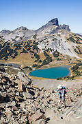 The volcanic pinnacle of Black Tusk rises above Black Tusk Lake (foreground) and Mimulus Lake, seen from Panorama Ridge Trail. The Black Tusk (2319 m or 7608 ft) is a remnant of an extinct andesitic stratovolcano which formed 1.3-1.1 million years ago: after long glacial erosion, renewed volcanism 170,000 years ago made the lava flow and dome forming the tooth-shaped summit. The top of Panorama Ridge is 17 miles round trip with 5100 feet gain from Rubble Creek parking lot (or 6 miles/10k RT with 2066 ft/630m gain from either Taylor Meadows or Garibaldi Lake Backcountry Campground). A hiking loop to Garibaldi Lake via Taylor Meadows Campground is 11 miles (18k) round trip, with 3010 ft (850m) gain. Garibaldi Provincial Park is east of the Sea to Sky Highway (Route 99) between Squamish and Whistler in the Coast Range, British Columbia, Canada.