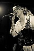 Solsikk performing at the Femme Metal Music Festival in London. Lead Singer in sepia tones