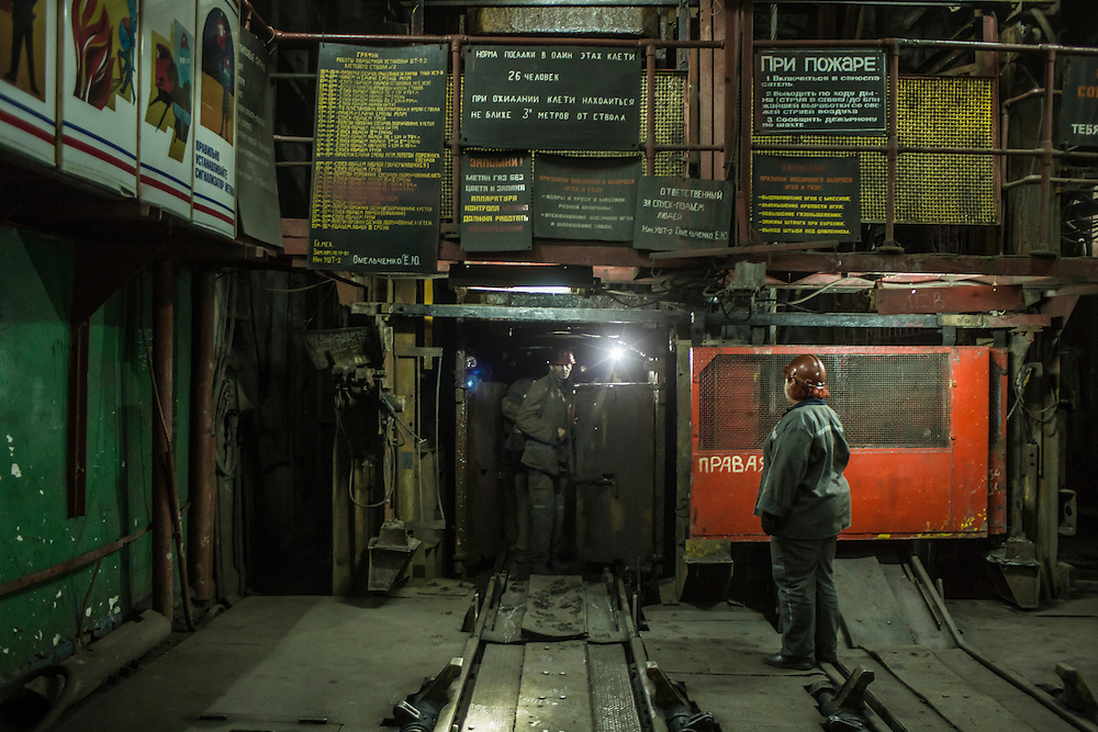 Miners board the elevator to go down underground at the Shcheglovskaya Coal Mine on Friday, March 25, 2016 in Makiivka, Ukraine.
