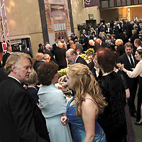 Stuart McDowell (left) is one of many mingling in the main hallway, where one of the food tables is located, at the 2007 Arts Gala at Wright State University, Saturday evening..