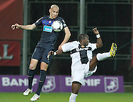 Portugal, FUNCHAL : Nacional's Angolan forward Mateus Costa (R) vies with Porto´s Brazilian defender Maicon (L) during their Portuguese league football match at Madeira Stadium in Funchal on March 16, 2012. PHOTO/ GREGORIO CUNHA.Estadio da Madeira, Funchal, Liga Portuguesa de futebol, Nacional vs Porto. .Maicon e Mateus.Foto Gregório Cunha