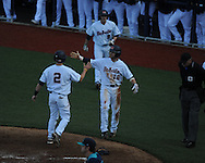 Ole Miss' Alex Yarbrough (2), Tanner Mathis (12), and Auston Bousfield (9) score vs. North Carolina-Wilmington's  at Oxford-University Stadium in Oxford, Miss. on Saturday, February 25, 2012. Ole Miss won 6-4.