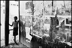 A girl stands near posters for Palestinians killed fighting Israel in the town of Tulkarem in the occupied West Bank.