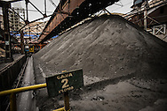 A large mound of lead prepared to be processed at Doe Run Peru smelter and refinery in La Oroya, Peru. The company produces lead and zinc marketed for its purity, however due to contamination from the smelter, the air, soil and water in La Oroya are far from pure.