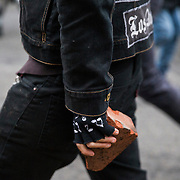 WASHINGTON, USA - January 20: An anti-Trump protestor holds a brick in his hands as he faces off with police after President Trump was sworn into office in Washington, USA on January 20, 2017.
