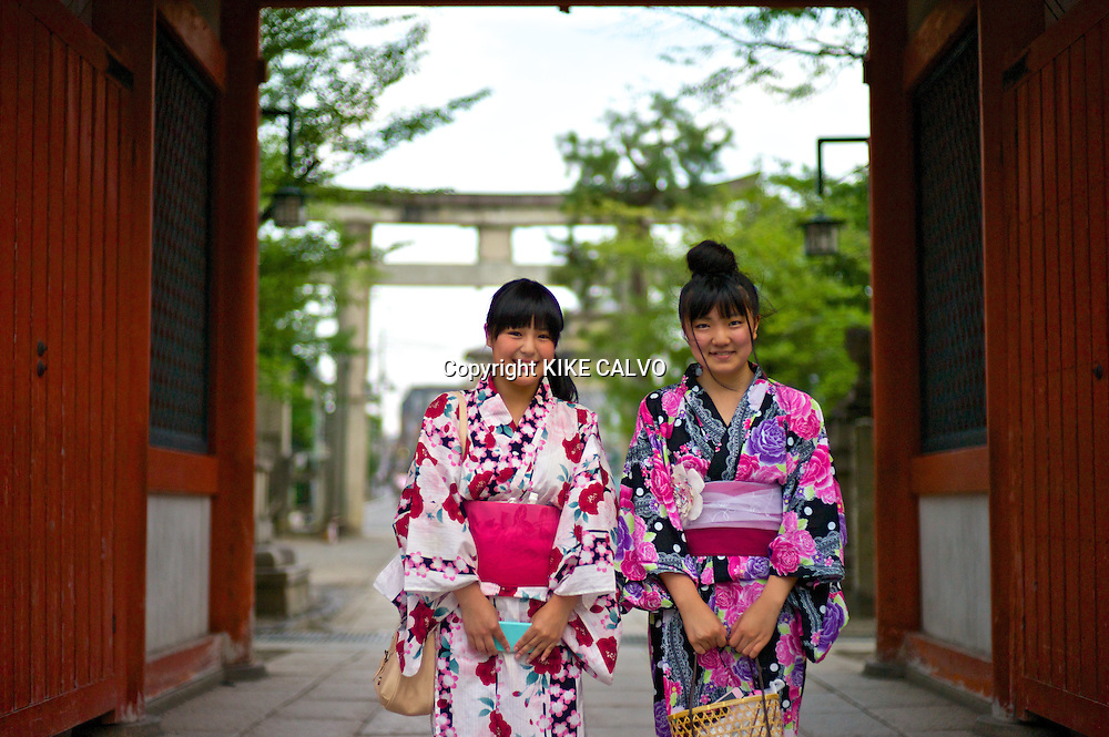 Portrait of an Asian teen wearing in traditional kimonos near the Kiyomizu Temple.